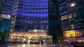 неон : BERLIN, GERMANY - APRIL 30, 2018. Sony Center inner courtyard in the evening Стоковые видеозаписи