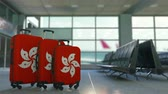 hk : Travel suitcases featuring flag of Hong Kong. Tourism conceptual animation Stock Footage