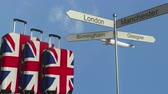 letreiro : Travel baggage featuring flag of Great Britain, airplane and city sign post. British tourism conceptual animation