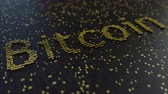 técnico : Bitcoin word made of moving golden numbers. Cryptocurrency mining or transactions related conceptual animation