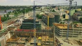 técnico : WARSAW, POLAND - JUNE 4, 2018. Aerial view of modern construction site in city centre Stock Footage