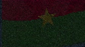 mektup : Waving flag of Burkina Faso made of text symbols on a computer screen. Conceptual loopable animation