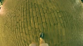 krok : Man walks on the pavemente in the evening. Fish-eye shot Wideo