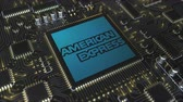 mikroişlemci : Computer printed circuit board or PCB with American Express Company logo. Conceptual editorial 3D animation Stok Video