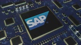 mikroişlemci : Computer printed circuit board or PCB with SAP SE logo. Conceptual editorial 3D animation