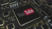 mikroişlemci : Computer printed circuit board or PCB with YouTube, LLC logo. Conceptual editorial 3D animation Stok Video