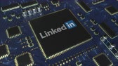 board : Computer printed circuit board or PCB with LinkedIn logo. Conceptual editorial 3D animation