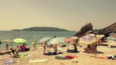 kids tent : BUDVA, MONTENEGRO - AUGUST 1, 2018. Time lapse of crowded pebble beach on sunny summer day