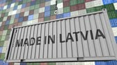 lotyšsko : Cargo container with MADE IN LATVIA caption. Latvian import or export related loopable animation