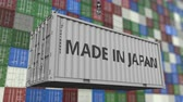 resim yazı : Cargo container with MADE IN JAPAN caption. Japanese import or export related loopable animation