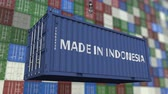 guindastes : Loading container with MADE IN INDONESIA caption. Indonesian import or export related loopable animation