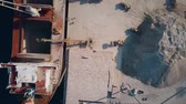 nautical equipment : Aerial top down shot of dry cargo ship and cement loaders at work