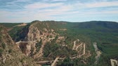 hilly : Aerial view of dam and bridge in mountainous area of Spain Stock Footage