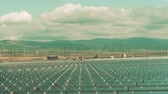 instalando : Ecologic energy production. Low altitude aerial view of solar power station and wind generators