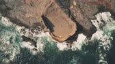 военно морской : Aerial top down view of sea tide and ancient fortress ruins on the rock. Andalusia, Spain Стоковые видеозаписи