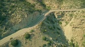 enforcement : Aerial view of a Guardia Civil car moving along windy road in Andalusian mountains, Spain