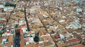 obydlí : Aerial view of old tiled sloping roofs and narrow streets in Granada centre, Spain