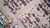 クレーン : Aerial top down view of a cargo ship and seaport container yard