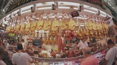 serrano : VALENCIA, SPAIN - SEPTEMBER 22, 2018. Fish-eye lens view of jamon and other Spanish meat specialties stall in Mercado Central or Central Market
