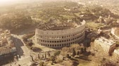 flavian : Aerial view of crowded famous Colosseum or Coliseum amphitheatre in Rome, Italy