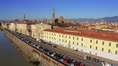 Aerial view of the Arno river embankment towards Florence Cathedral or Cattedrale di Santa Maria del Fiore. Italy