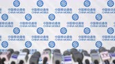 mike : Press conference of CHINA MOBILE, press wall with logo and microphones, conceptual editorial animation Stock Footage