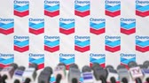 zprávy : News conference of CHEVRON, press wall with logo as a background and mics, editorial animation