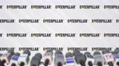 anúncio : Media event of CATERPILLAR, press wall with logo and microphones, editorial animation Stock Footage