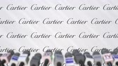 copertura : News conference of CARTIER, press wall with logo as a background and mics, editorial animation