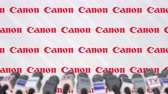 mike : CANON company press conference, press wall with logo and mics, conceptual editorial animation