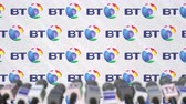 coverage : BRITISH TELECOM company press conference, press wall with logo and mics, conceptual editorial animation