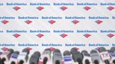 zpráv : Press conference of BANK OF AMERICA, press wall with logo and microphones, conceptual editorial animation