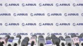 аэробус : Press conference of AIRBUS, press wall with logo and microphones, conceptual editorial animation