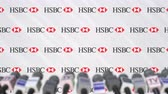 coverage : Media event of HSBC, press wall with logo and microphones, editorial animation
