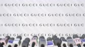 televizyon : Press conference of GUCCI, press wall with logo and microphones, conceptual editorial animation