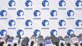 prasa : Media event of DANONE, press wall with logo and microphones, editorial animation