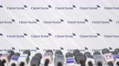 anúncio : CREDIT SUISSE company press conference, press wall with logo and mics, conceptual editorial animation Stock Footage