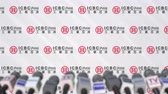 coverage : News conference of ICBC, press wall with logo as a background and mics, editorial animation Stock Footage