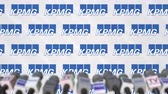 coverage : KPMG company press conference, press wall with logo and mics, conceptual editorial animation