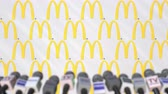conferenza stampa : Media event of MCDONALDS, press wall with logo and microphones, editorial animation