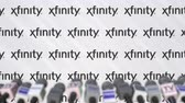 передача : XFINITY company press conference, press wall with logo and mics, conceptual editorial animation Стоковые видеозаписи