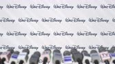 coverage : Press conference of WALT DISNEY, press wall with logo and microphones, conceptual editorial animation