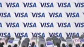 coverage : Media event of VISA, press wall with logo and microphones, editorial animation Stock Footage