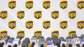 misa : UPS company press conference, press wall with logo and mics, conceptual editorial animation Archivo de Video