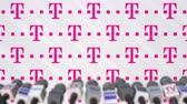 mass media : Media event of T TELEKOM, press wall with logo and microphones, editorial animation Filmati Stock