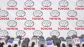 coverage : TOYOTA company press conference, press wall with logo and mics, conceptual editorial animation