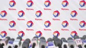 totaal : News conference of TOTAL, press wall with logo as a background and mics, editorial animation