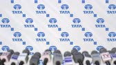 conferenza stampa : TATA company press conference, press wall with logo and mics, conceptual editorial animation