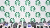 средства массовой информации : STARBUCKS company press conference, press wall with logo and mics, conceptual editorial animation Стоковые видеозаписи
