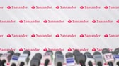coverage : Media event of SANTANDER, press wall with logo and microphones, editorial animation Stock Footage